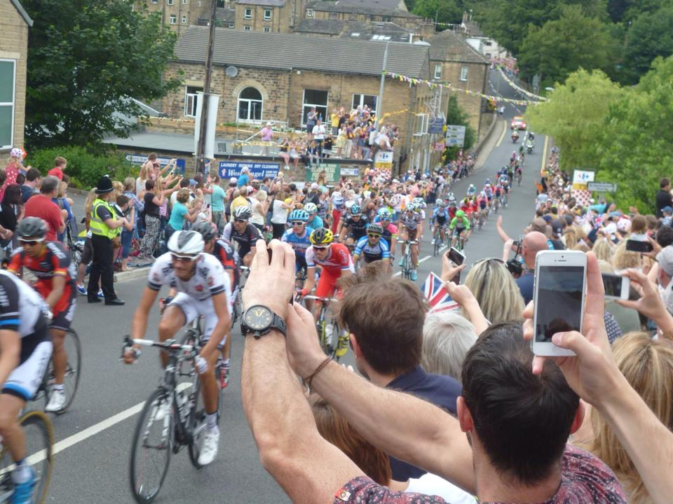 The peleton just coming up Ripponden Bank! Happy crowds!